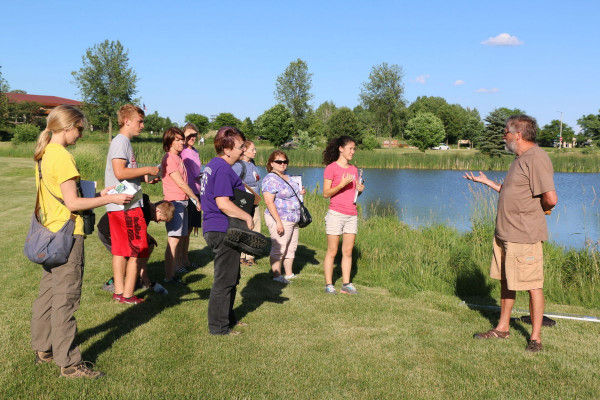 "Robert Bohanan, an ecologist at WISCIENCE, helped develop ""Econauts"" and often reinforces learning with field trips to the lake. <i>Photo courtesy of Amber Levenhagen of the Verona Press</i>"