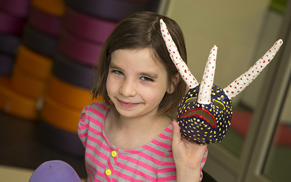 Grace Halverson, daughter of education researchers Erica & Rich Halverson, shares a handmade mask created at The Bubbler