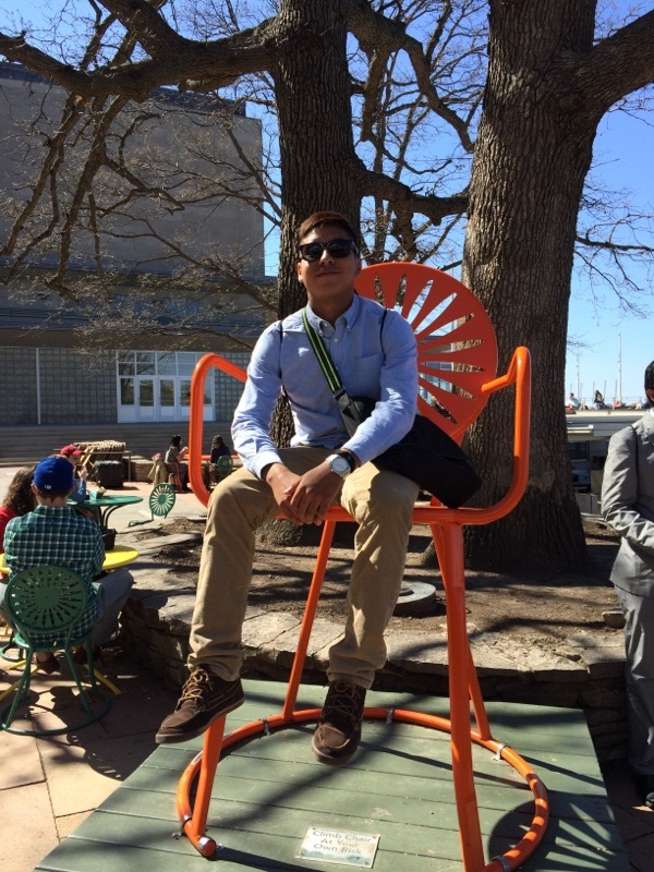 Gary Ulunque of Yorktown High School in Arlington, Va., takes a break in the iconic terrace chair during his first-ever visit to Wisconsin for the 2015 MSAN Institute.