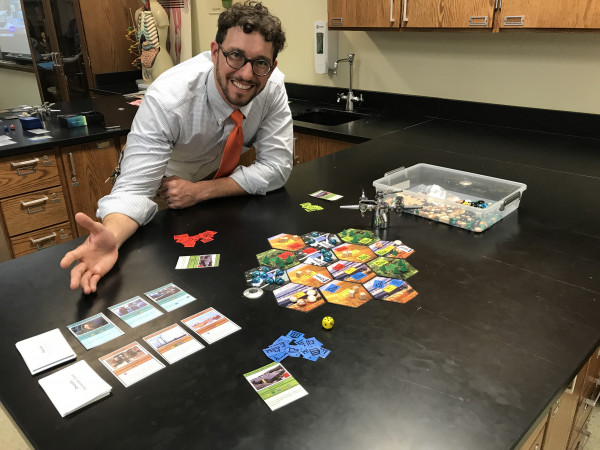 "Mike Lawton, a Milwaukee teacher, created an ecologically themed board game, ""Dwindle,"" after playing ""Econauts."""