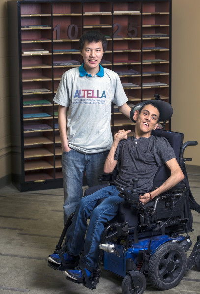 Cha Kai Yang, left, and Miguel Hernandez Bolanos are important members of the ALTELLA team, assisting staff with office tasks.
