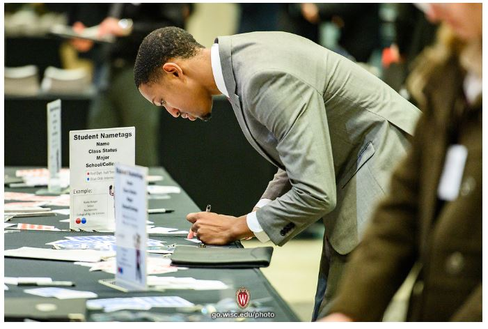 A student searches for his first job after college at a UW-Madison career fair.